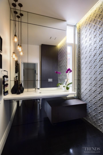 Pressed metal wall is standout feature in this sleek space. Image: 1
