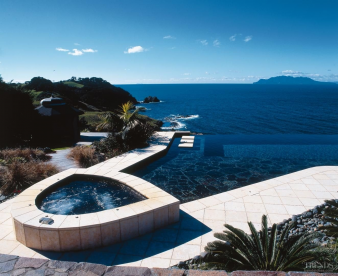 3. This clifftop pool was designed to maximise a spectacular sea view. It features an infinity edge, concrete stepping stones and an adjoining spa.. Image: 3