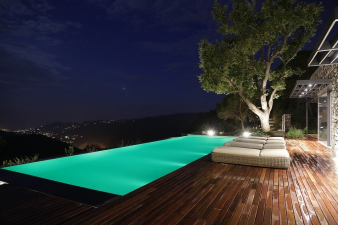 6. This infinity edge pool is lit up at night, affording swimmers, illuminated, fantastic views. Image: 6