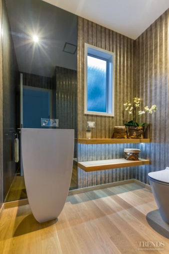 1 – A corrugated iron-look wallpaper provides a backdrop for powder room. Image: 1