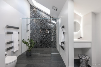 3 – Mosaic feature walls add sparkle to modern bathroom design. Image: 3