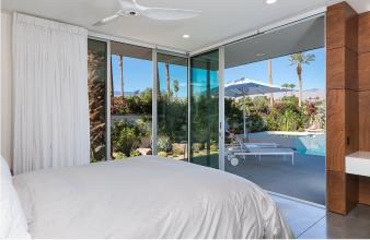 This bedroom has easy access to the pool and outdoor living areas. Image: 10