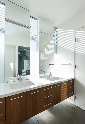 Bathroom with floating vanity incorporating double built in sinks. Image: 11