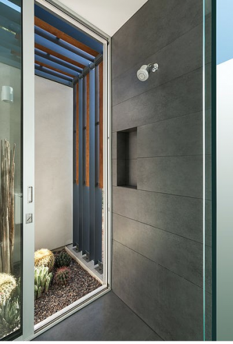 Shower opening to a small courtyard  garden planted in cacti. Image: 12