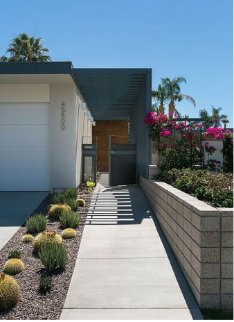 Garage and entrance to the home – with cacti and other planting that can withstand the seasonal harsh desert conditions. Image: 2