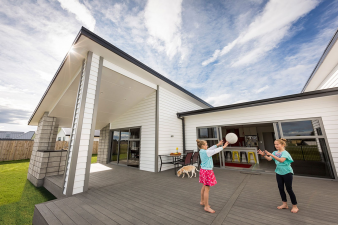 Lovely family home clad with Envira bevel back weatherboards. Image: 1